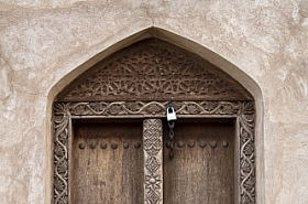 Omani Stock Photo of Omani traditional style wooden door with iron knob